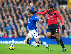LIVERPOOL, ENGLAND - Saturday, February 20, 2010: Everton's Steven Pienaar and Manchester United's Antonio Valencia during the Premiership match at Goodison Park. (Photo by: David Rawcliffe/Propaganda)