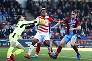 Doncaster Rovers forward Mallik Wilks (7), on loan from Leeds United is thwarted by Scunthorpe United  during the EFL Sky Bet League 1 match between Scunthorpe United and Doncaster Rovers at Glanford Park, Scunthorpe, England on 23 February 2019.