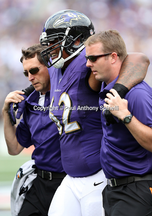 Baltimore Ravens nose tackle Terrence Cody (62) gets help off the field after incurring a leg injury during the NFL week 3 football game against the Houston Texans on Sunday, Sept. 22, 2013 in Baltimore. The Ravens won the game 30-9. ©Paul Anthony Spinelli