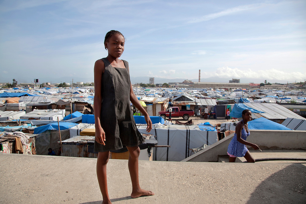 A girl in the makeshift refugee camp, La Piste, in Port-au-Prince, Haiti on July 17, 2010. La Piste (French for &quot;runway&quot;)is a settlement sprawled across the site of a disused airport and now home to an estimated 20,000 earthquake survivors living in makeshift structures.<br /> Six month after a catastrophic earthquake measuring 7.3 on the Richter scale hit Haiti on January 13, 2010, killing an estimated 230,000 people, injuring an estimated 300,000 and making homeless an estimated 1,000,000.