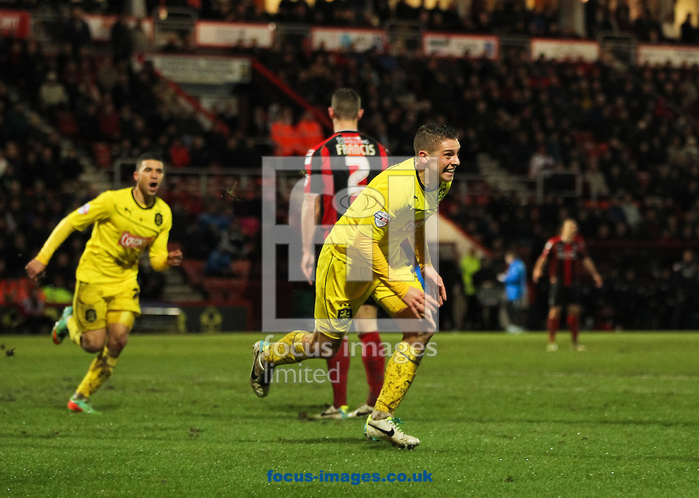Picture by Tom Smith/Focus Images Ltd 07545141164<br /> 28/01/2014<br /> Calum Woods (centre) of Huddersfield Town celebrates scoring his sides first goal during the Sky Bet Championship match at the Goldsands Stadium, Bournemouth.