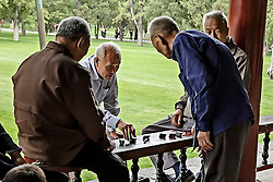 Old men are playing a game.