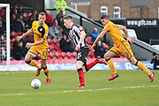 Grimsby Town midfielder Harry Clifton (15) shoots at goal  during the EFL Sky Bet League 2 match between Grimsby Town FC and Port Vale at Blundell Park, Grimsby, United Kingdom on 10 March 2018. Picture by Mick Atkins.