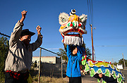 Gary Low, (left), of the Chinese Cultural Center, coaches dancers, Jordan Sorensen, 12, and Jasper Sorensen, 11, before the start of the Tucson Rodeo Parade, the longest non-motorized parade in the nation. This 89-year-old event occurs each February in conjunction with La Fiesta de los Vaqueros, the Tucson Rodeo.  The event draws over 150,000 spectators in southern Tucson.