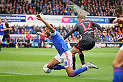 Bolton Wanderers midfielder Craig Noone (12) fouls Ipswich Town midfielder Grant Ward (18) on the edge of the box during the EFL Sky Bet Championship match between Ipswich Town and Bolton Wanderers at Portman Road, Ipswich, England on 22 September 2018.