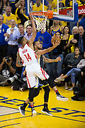 Golden State Warriors guard Stephen Curry (30) lays the ball up against the Houston Rockets during Game 4 of the Western Conference Finals at Oracle Arena in Oakland, Calif., on May 22, 2018. (Stan Olszewski/Special to S.F. Examiner)