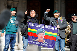 © Licensed to London News Pictures.15/03/2017.London, UK. Campaigners celebrate outside the Royal Courts of Justice in London, where a ruling was made in an appeal against the conviction of Sgt Blackman.  Also known as Marine A, Sgt Blackman's life sentence for the murder of a wounded Taliban fighter in Afghanistan in 2011 reduced to manslaughter.Photo credit: Tolga Akmen/LNP