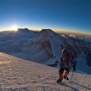 Dave Hahn ascends the North Ridge of Everest at sunset toward Camp V. Changtse, Gyachung Kang, and Cho Oyu rise behind.