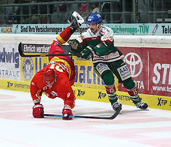 28.11.2014, Curt Frenzel Stadion, Augsburg, GER, DEL, Augsburger Panther vs Duesseldorfer EG, 21. Runde, im Bild Auch beim Bodenturnen waren die Duesseldorfer ueberlegen, Drew Schiestel (Duesseldorfer EG) gegen James Bettauer Augsburger Panther #15) // during Germans DEL Icehockey League 21th round match between Augsburger Panther and Duesseldorfer EG at the Curt Frenzel Stadion in Augsburg, Germany on 2014/11/28. EXPA Pictures © 2014, PhotoCredit: EXPA/ Eibner-Pressefoto/ Krieger<br /> <br /> *****ATTENTION - OUT of GER*****