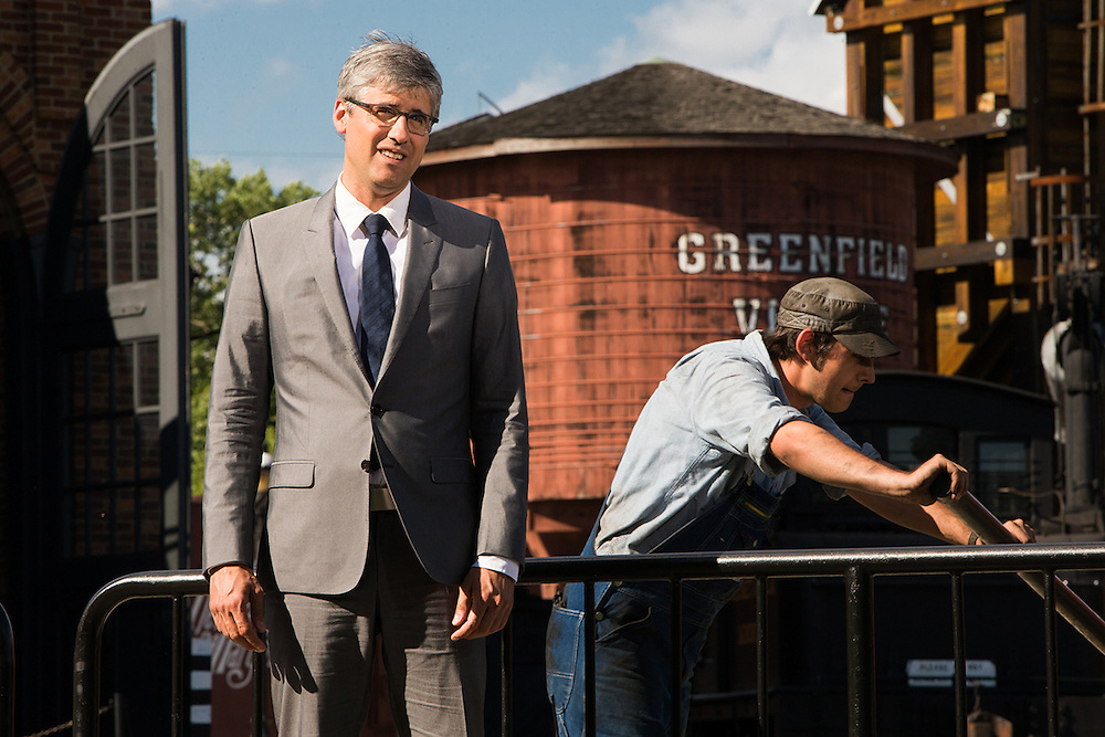 Mo Rocca preparing to film a scene at the Roundhouse at Greenfield Village for CBS Saturday morning's The Henry Ford's Innovation Nation.