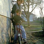 Serbian enclave in Kosovo.  Some children are born in the enclave and never been outside of it.