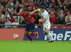 England's Gary Cahill (Chelsea) puts pressure on Norway's Joshua King  - Photo mandatory by-line: Alex James/JMP - Mobile: 07966 386802 - 3/09/14 - SPORT - FOOTBALL - London - Wembley Stadium - England v Norway - International Friendly