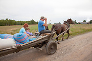 Polish family going to market in a horse drawn wagon. Zawady Central Poland