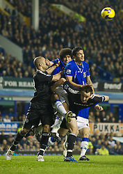 LIVERPOOL, ENGLAND - Monday, December 22, 2008: Everton's Marouane Fellaini and Tim Cahill are pulled down by Chelsea's Alex and captain John Terry during the Premiership match at Goodison Park. (Photo by David Rawcliffe/Propaganda)