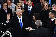 Vice President-elect Mike Pence is sworn-in as the Vice President as he wife Karen Pence holds the Bible during the 45th Presidential Inaugural on Capitol Hill January 20, 2017 in Washington, DC.