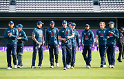Picture by Allan McKenzie/SWpix.com - 19/05/2019 - Sport - Cricket - 5th Royal London One Day International - England v Pakistan - Emerald Headingley Cricket Ground, Leeds, England - England's Chris Woakes leads his side off the field after victory over Pakistan in the Royal London One Day Series.