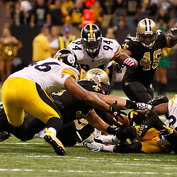 Oct 31, 2010; New Orleans, LA, USA; Players for the New Orleans Saints and Pittsburgh Steelers scramble for a fumble during the second half at the Louisiana Superdome. The Saints defeated the Steelers 20-10.  Mandatory Credit: Derick E. Hingle..