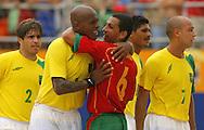 Football-FIFA Beach Soccer World Cup 2006 - Semi Finals, Brazil - Portugal, Beachsoccer World Cup 2006..Brasilian's Junior Negao and Portugal's Alan.Rio de Janeiro - Brazil 11/11/2006. Mandatory credit: FIFA/ Manuel Queimadelos