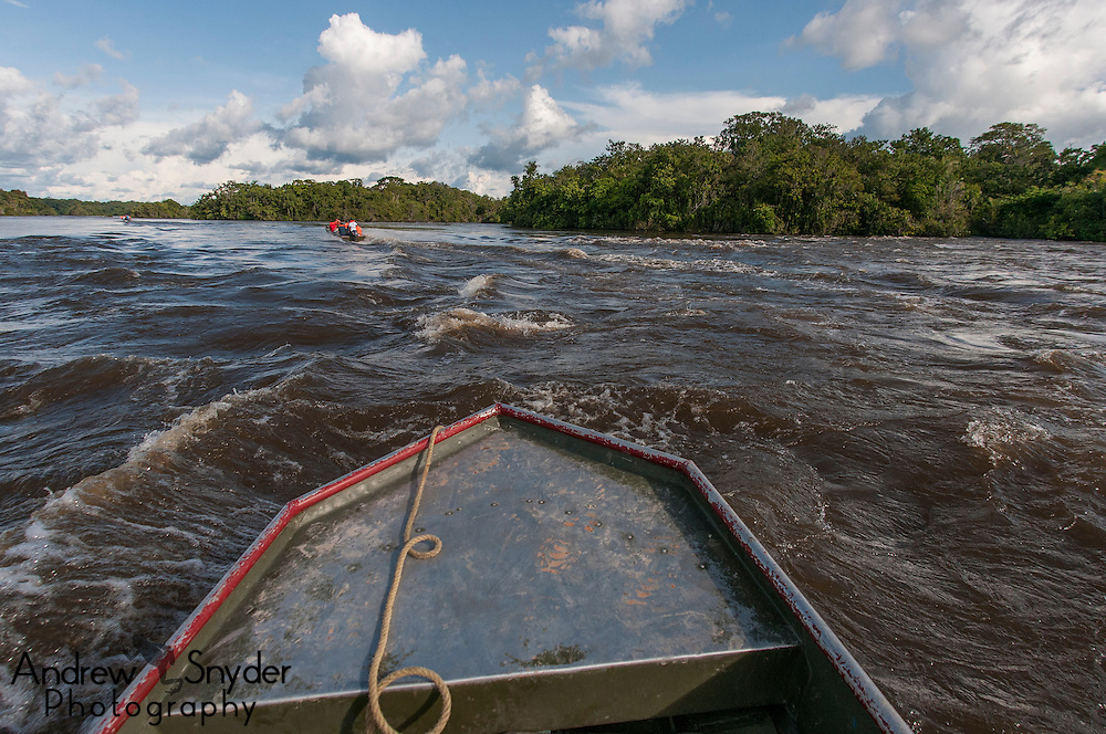 Traveling between camps along the Essequibo River in Guyana within the Iwokrama forest boundaries.