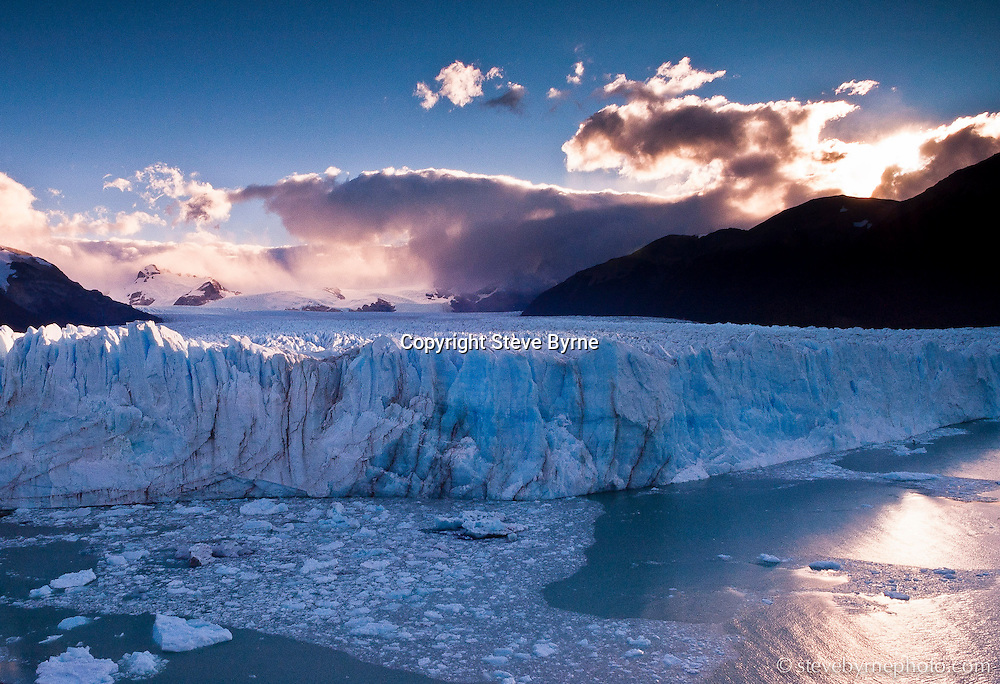 Lifting weather reveals the grandeur of the Perito Moreno Glacier and the Southern Ice Cap.  Parque Nacional de los Glaciares, Argentine Patagonia.
