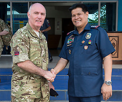 Image shows Lieutenant Colonel Harry Walker with Police Senior Superintendent Jose Santiago Hidalgo Jr. outside the Philippine National Police Offices in Manila.<br /> <br /> Members of 77 Brigade on Exercise Civil Bridge 14A today visited the Philippine National Police offices &amp; The Rescue Emergency Disaster Training Facility, City of Pasig in Manila to discuss their earthquake contingency plans.<br /> 24/04/2015<br /> <br /> Credit should read: Cpl Mark Larner RY<br /> <br /> Exercise Civil Bridge is being conducted by elements of 77 Brigade &ndash; a specialist British military unit that is working alongside the government and disaster relief organisations as part of an annual overseas training exercise. <br /> <br /> Their mission during the two-week deployment will be to look at examples of the existing Philippine earthquake contingency response plans and, working with Philippine colleagues, make suggestions that will help save lives by enhancing the country&rsquo;s ability to respond to an earthquake in an urban setting.