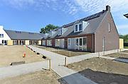 Nederland, Leuth, 6-7-2017In dit dorp in de Ooijpolder worden door een private vastgoed investeerder14 nieuwe sociale woningen gebouwd, bedoeld voor de goedkope, betaalbare  huur aan lokale vooral jongeren. Foto: Flip Franssen