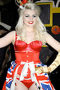 Duchess of Cambridge's burlesque-dancing cousin brings her striptease act to New York<br /> <br /> The Duchess of Cambridge's buxom burlesque dancer cousin is bringing her raunchy routine to the U.S.<br /> Katrina Darling, the self-proclaimed 'Royal family's closest brush with soft porn', will be performing her scantily-clad, X-rated show in SoHo. <br /> The dancer, who is a Barclays banker by day, is Catherine and Pippa's second cousin once removed, as her grandmother and the Middleton sisters' great-grandmother, Lily, were sisters.<br /> The 21-year-old tassel twirling dancer, who has sported flame red, peroxide blonde, sugar pink and sophisticated black hair-dos so far in her career, will bring her racy God Save the Queen show to WIP club.<br /> <br /> The Sunderland local told the New York Post that she is ready to 'push the envelope' with her striptease routine on March 13.<br /> 'New York is a lot more out there than the UK scene,' she said.<br /> London sticks more to the traditional burlesque side of things, whereas New York really pushes the envelope.'<br /> She told the newspaper that she is unafraid to strip in front of a crowd, but is careful not to take her act too far. 'I take my clothes off, but I don't give away anything that should be kept for someone else.'<br /> Though she has never met the Middleton sisters, Ms Darling has appeared on a U.S. TV documentary dedicated to Pippa.<br /> <br /> Credited as a family insider and part of the 'inner circle' of Middletons, Ms Darling was completely unaware that she was related to Prince William's beau until contacted by producers.<br /> The royal family have not commented on her raunchy act - despite its suggestive name - and the Post said a 'giggling royal rep' had no word to add.<br /> ©Exclusivepix