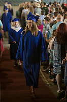 Julia Normandin walks towards the stage with her fellow graduates for the 42nd commencement exercises for Gilford High School Saturday morning at Meadowbrook.  (Karen Bobotas/for the Laconia Daily Sun)