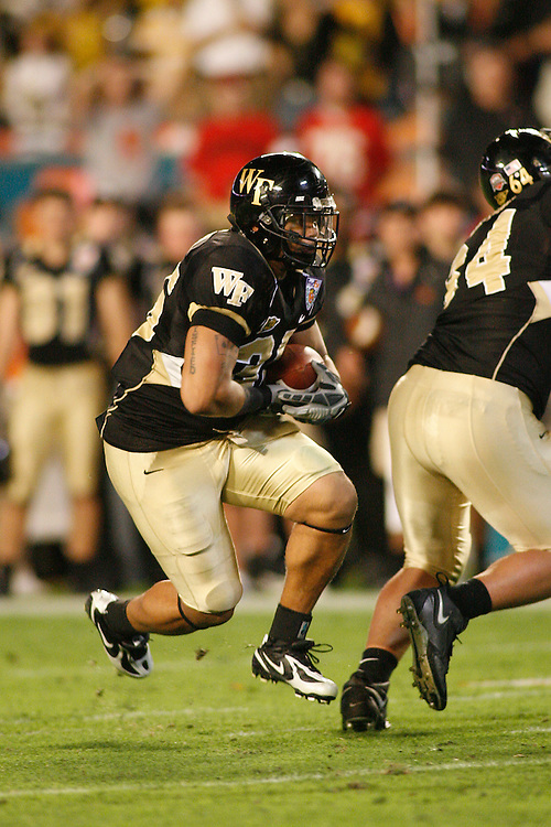 Wake Forest University running back Rich Belton rushes upfield during the Louisville Cardinals 24-13 victory over the Wake Forest Demon Deacons at the 2007 Orange Bowl Game on January 2, 2007 at the Dolphin Stadium in Miami, Florida.