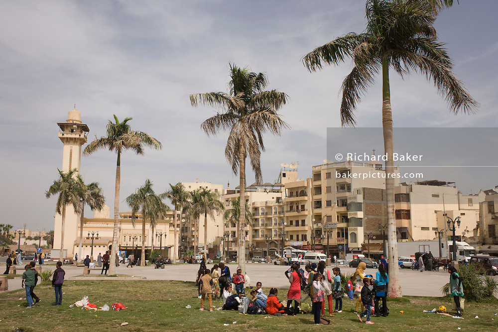 Egyptians sociali in the main square in Luxor, Nile Valley, Egypt. ing