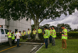 A crew gathers for a meeting to prepare for the incoming Hurricane Irma at Orlando Utilities Commission on Sep. 8, 2017. (Photo by Aileen Perilla/Orlando Sentinel/TNS/Sipa USA)
