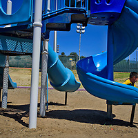 Darin Bestor,6, slides down the slide at Ford Canyon Park on Thursday in Gallup. Darin was at the park with his mother, Cindy, 10 year old sister, Tasha, along with their 7 month old cousin who Cindy was babysitting.