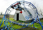 John Ivers loves roller coasters, but can't stand waiting in line. So he built  the Blue Flash in his backyard.