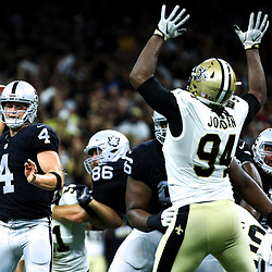 Sep 11, 2016; New Orleans, LA, USA;  Oakland Raiders quarterback Derek Carr (4) is pressured by New Orleans Saints defensive end Cameron Jordan (94) during the fourth quarter of a game at the Mercedes-Benz Superdome. The Raiders defeated the Saints 35-34. Mandatory Credit: Derick E. Hingle-USA TODAY Sports