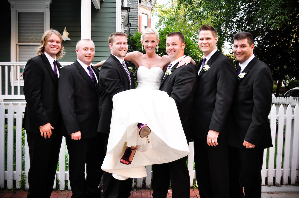 Kelly is held up by her two brothers, along with the other groomsmen in Old Town, Chicago, IL