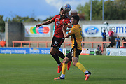 Aaron Wildig of Morecambe and Padraig Amond of Newport County battle for a high ball during the EFL Sky Bet League 2 match between Morecambe and Newport County at the Globe Arena, Morecambe, England on 16 September 2017. Photo by Mick Haynes.