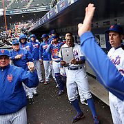 NEW YORK, NEW YORK - MAY 04:  Curtis Granderson #3 of the New York Mets holds up an iPad as the dugout celebrates a home run by Lucas Duda as he returns to the dugout during the Atlanta Braves Vs New York Mets MLB regular season game at Citi Field on May 04, 2016 in New York City. (Photo by Tim Clayton/Corbis via Getty Images)