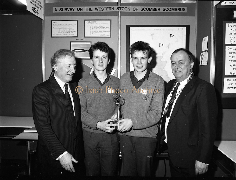 08/01/1988.01/08/1988.8th January 1988 .The Aer Lingus Young Scientist of the Year Award at the RDS, Dublin ..Picture shows (L-R) the Taoiseach Charles Haughey, T.D., Kevin Mc Cauley, Fergal Mc Aleavey, both from Abbey Vocational School, Donegal Town whose project 'A Survey of the Western Stock of Scomber Scombrus' which won the Best Group and Michael Hanley, President of the Teachers Union of Ireland.