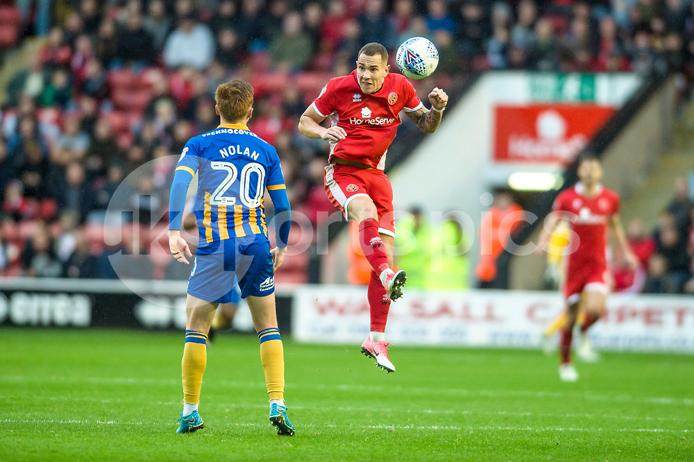 Kieron Morris of Walsall wins a header during the EFL Sky Bet League 1 match between Walsall and Shrewsbury Town at the Banks's Stadium, Walsall, England on 7 October 2017. Photo by Darren Musgrove.