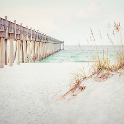 Pensacola Beach Gulf Pier and  beach grass retro photo. Pensacola Beach is a coastal city along the Emerald Coast in the Southeastern United States. Photo is high resolution. Copyright ⓒ 2018 Paul Velgos with All Rights Reserved.