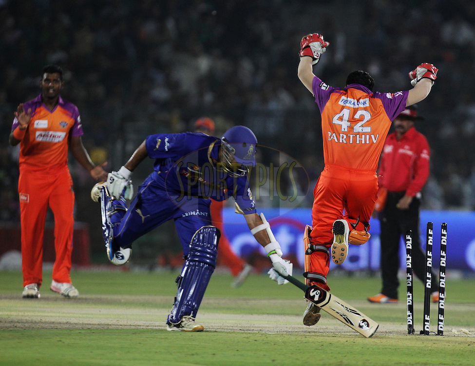 Kochi Tuskers Kerala player Parthiv Patel celebrates after running out Rajasthan Royals player Rahul Dravid during match 28 of the Indian Premier League ( IPL ) Season 4 between the Rajasthan Royals and the Kochi Tuskers Kerala held at the Sawai Mansingh Stadium, Jaipur, Rajasthan, India on the 24th April 2011..Photo by BCCI/SPORTZPICS.