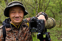 Nature photographer Mr. Xu Yongchun,Tangjiahe National Nature Reserve, NNR, Qingchuan County, Sichuan province, China