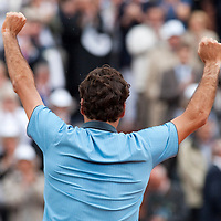 7 June 2009: Roger Federer of Switzerland celebrates his victory against Robin Soderling of Sweden during the Men's Singles Final match on day fifteen of the French Open at Roland Garros in Paris, France.