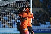 Colchester United forward Gavin Massey (11) scores a goal and celebrates to make the score 0-1 during the Sky Bet League 1 match between Coventry City and Colchester United at the Ricoh Arena, Coventry, England on 29 March 2016. Photo by Simon Davies.
