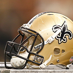 August 17, 2012; New Orleans, LA, USA; A New Orleans Saints helmet sit on a equipment box during the second half of a preseason game against the Jacksonville Jaguars at the Mercedes-Benz Superdome. The Jaguars defeated the Saints 27-24.  Mandatory Credit: Derick E. Hingle-US PRESSWIRE