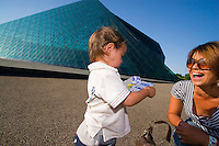 A mother and young son play in front of the giant glass pyramid, one of many 'statues' in the Moerenuma Park, designed by the famous Japanese sculptor Isamu Noguchi.