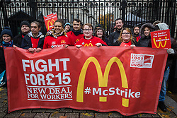 London, UK. 12 November, 2019. McDonald's workers belonging to the Bakers Food & Allied Workers Union (BFAWU) line up behind a banner outside Downing Street during strike action, dubbed a 'McStrike', to call for a New Deal for McDonald's Workers which would include £15 an hour, an end to youth rates, the choice of guaranteed hours of up to 40 hours a week, notice of shifts four weeks in advance and union recognition.
