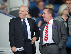 LIVERPOOL, ENGLAND - Saturday, October 1, 2011: Former Everton player Peter Reid and Liverpool's Commercial Director Ian Ayre during the Premiership match at Goodison Park. (Pic by David Rawcliffe/Propaganda)