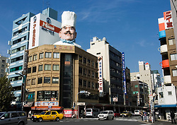 Large chefs head on building at Kappabashi kitchen product buying district in central Tokyo