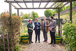 Pictured: Maia Gordon, Keith Brown,  George Elliis and Josiah Lockhart<br /> <br /> Cabinet Secretary for Economy, Jobs & Fair Work Keith Brown visited Gorgie City Farm today  to mark their accreditation as the 800th Living Wage employer in Scotland. Mr Brown met Josiah Lockhart, CEO and undertook a short tour of the farm, celebrating their accreditation and promoting the Living Wage more generally. The Scottish Government has set a target of reaching 1,000 Scottish-based Living Wage Accredited Employers by autumn 2017. While at the farm Mr Brown met Maia Gordon, Kirsty McGoff (17) and Zoe White (18), who have benefited from the living wage, and George Ellis, chair of the farm's board of directors<br /> Ger Harley | EEm 18 May 2017